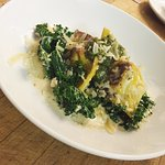 House made tortellini stuffed with ricotta, topped with kale in a garlic cream pinon pesto.