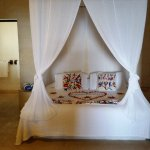 Canopy bed with a welcoming flower arrangement