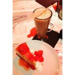 Latte and NY cheesecake. Latte served with sugar candy stick. Was fun and playful.