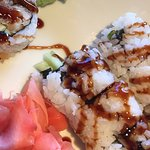 Found strand of thick black hair wrapped around sushi! Complained & waitress took it back. Came