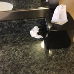 Dirty tissues left in room on sink.