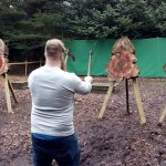 Throwing 2 axes into the same target.