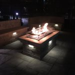Outdoor fire pit with seating area.