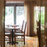 Our dining room overlooks 3 beautiful acres of the surrounding forest (P