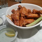 Chicken wings in hot sauce with Mama blue cheese
