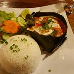 Amok Curry in banana leaf bowl with rice and vegetables