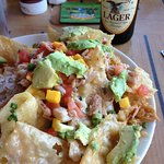 Blue Crab Nachos (appetizer) with an adult beverage