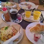 Hungarian Breakfast (croissant, orange juice, warm drink, omelet with cheese, hungarian sausage
