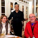 My colleagues, Saya and John, bracket our delightful server Myrka Isaac.