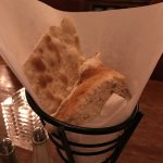 Yummy bread served with a side of softened butter, and the most delicious green chili hummus!