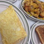 Tomato cheese omelet with Cajun hash browns and rye roast