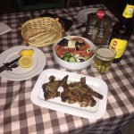 Lamb Chops with Greek Salad and local beer at Tavernaki restaurant