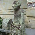 Traditional sculpture at doorway of building