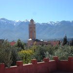 Atlas mountains and minaret taken from roof terrace area