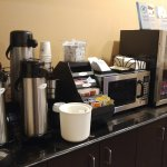 Coffee, microwave and yogurt area of complimentary breakfast