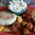 Fried egg, bacon & cheese muffin w/Pops potatoes plus my side of cottage cheese