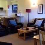 Lounge showing kitchen behind