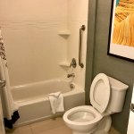 Clean; toilet seemed to be water-saving; right-hand shower corner can flood the floor a little