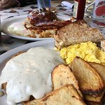 Country fried (angus) steak and eggs (foreground) and signature cinnamon roll French toast (back