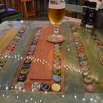 Beer cap tabletop. (Hard to get a good shot with low light...)