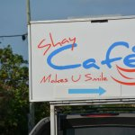 Shay Cafe's sign is on the back of their truck parked on the side of the road.. (smart!)