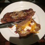 New York Strip with loaded baked potatoe