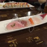 Sashimi sampler with Mars roll in the background.