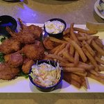 Coconut shrimp, fried scallops, fries, cole slaw