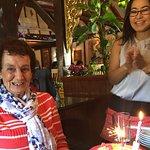 Staff giving Mum her cake