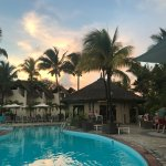 The pool and Baracuda Bar at sunset.