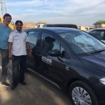 Rajesh and the car he drove us around in