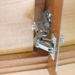 Close up showing the poor design hinge which made the drawers useless