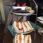 Vegan afternoon tea. Homous and roasted veg sandwich. Fruit salad, seed and nut bar and dark min