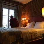 Our bed - loved the exposed brick!