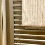 Towel warmer in room Rosa damaged yet staff try to cover with towels
