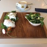 Poached eggs with salad and cappuccino