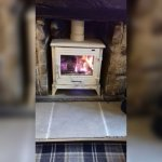 Wood burning stove in the lounge baf