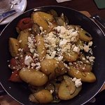 Potatoes and vegetables in olive oil with feta cheese