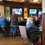 Big bar with televisions.
