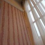 Damp and dirty walls. Cobwebs and wallpaper coming off.