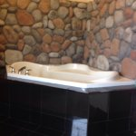 Stay-cation. The room jacuzzi was able to comfortably fit two larger people. Fire place, pool, m