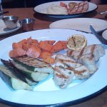 My Charbroiled Ono with glazed carrots and grilled zucchini. My husband's salmon in rear.