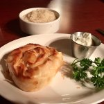 Tiropita, a Greek cheese pie entombed in phyllo pastry with a side of rice pilaf and tzatziki sa