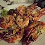 Perfectly cooked alf a kilo of fresh prawns in garlic butter.