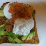 delicious poached egg, advocado and tomato salsa