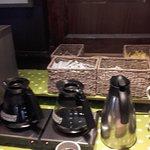 Beware of scalding hazard as coffee pots in the front of sugar/sweeteners etc