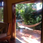 Double doors opening to our porch with table, hammock and pool. So comfortable and Tico!