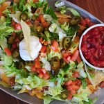Macho Nachos: Tortilla Chips with chili, jack & cheddar cheeses, tomatoes & jalapeños.