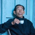 Etienne says he's usually found drinking tea under his portrait of Ho Chi Minh