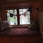 Belknap Cabin, window seat in loft area. There's a pull out trundle bed underneath.